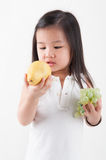 Eating fruits Stock Images