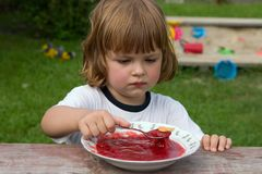 Eating frut jelly Royalty Free Stock Photo
