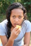 Eating girl royalty free stock photos