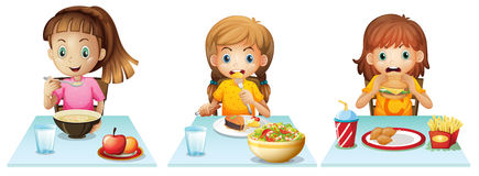 Eating. Girls eating at the dining table royalty free illustration