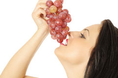 Eating grapes Stock Photo