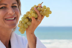 Eating grapes by the sea Royalty Free Stock Photography