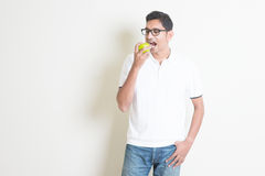 Eating green apple royalty free stock photos