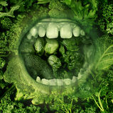 Eating Green. And healthy food concept with an open human mouth on a background of produce eating fresh vegetables as a symbol of good diet and nutrition and Royalty Free Stock Photos