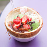 Eating Green Tea ice cream with strawberry and jellys Royalty Free Stock Image