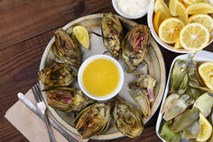 Eating Grilled Artichokes Royalty Free Stock Photos