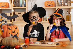 Eating Halloween treats Stock Images