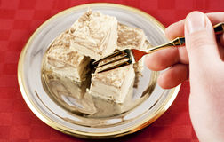 Eating Halva Stock Photography