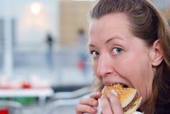 Eating hamburger Stock Images