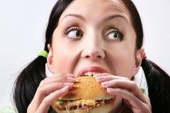 Eating hamburger Stock Image