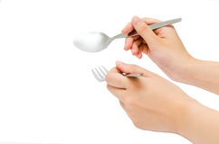 Eating. Hands holding fork and spoon Stock Photo