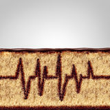 Eating And Health Food Concept. Eating and health concept as a cake with the filling shaped as an ekg or ecg monitor pattern as a medical or medicine risk symbol Royalty Free Stock Image