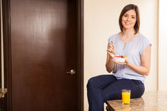 Eating a healthy breakfast at home Stock Images