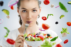 Eating healthy food. A beautiful girl eating healthy food Royalty Free Stock Photo