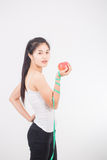 Eating and heath concept - beautiful sporty woman with measuring Royalty Free Stock Image