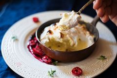 Eating home made Baked aAlaska Royalty Free Stock Images