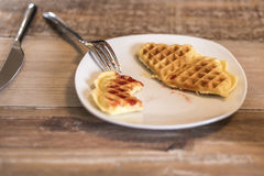 Eating Homemade waffles on white plate with red strawberry jam jelly stock image