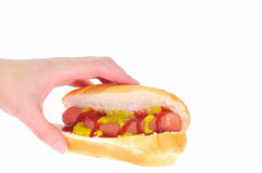 Eating a hot dog. Stock Image