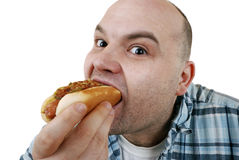 Eating a hot dog. Man is about eating a hot dog Stock Photo