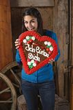 Eating a huge heart cookie Stock Photos