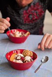 Eating ice cream Stock Images