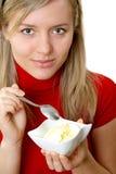 Eating ice cream. Beautiful girl eating ice cream, separate on white Royalty Free Stock Photos