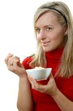 Eating ice cream. Beautiful girl eating ice cream, separate on white Royalty Free Stock Photography