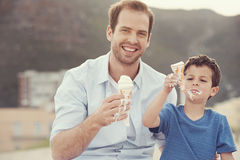 Eating icecream together Royalty Free Stock Images