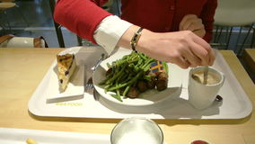 Eating at IKEA stock footage