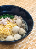 Eating instant noodle with minced pork and pork ball Stock Photos