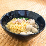 Eating instant noodle with minced pork and pork ball Stock Photo