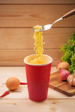 Eating Instant noodles in cup with a fork Royalty Free Stock Image