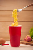 Eating Instant noodles in cup with a fork Royalty Free Stock Photo