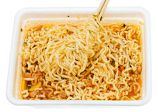 Eating of instant noodles from lunch box Stock Image