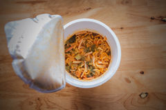Eating Instant Noodles Stock Images