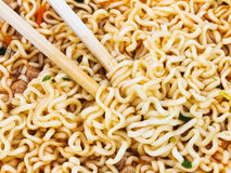 Eating instant noodles by wooden chopsticks Royalty Free Stock Photography