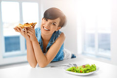 Eating Italian Food. Woman Eating Pizza. Fast Food Nutrition. Li. Eating Italian Food. Closeup Portrait Of Happy Healthy Caucasian Woman Eating Pizza Indoors Royalty Free Stock Photos