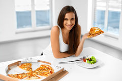 Eating Italian Food. Woman Eating Pizza. Fast Food Nutrition. Li. Eating Italian Food. Closeup Portrait Of Happy Healthy Caucasian Woman Eating Pizza Indoors Stock Images