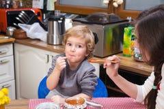 Eating jam for breakfast. Stock Images