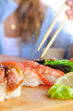 Eating japanese food Stock Photography