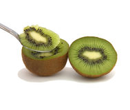 Eating a Kiwi. A halve of a kiwi and a spoon Royalty Free Stock Images