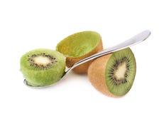 Eating kiwifruit with a teaspoon isolated Stock Photos