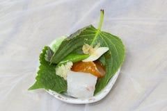 Eating Korean Raw Fish. How to eat Korean Sashimi (Raw Fish Royalty Free Stock Image