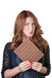 Eating a large chocolate bar Royalty Free Stock Photos