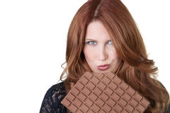 Eating a large chocolate bar Royalty Free Stock Images