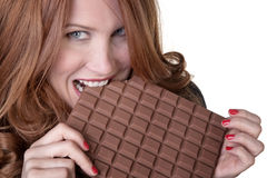 Eating a large chocolate bar Stock Photography