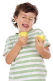 Eating a lemon Royalty Free Stock Photo