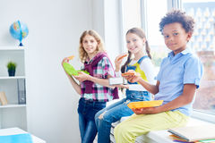 Eating after lesson Stock Images