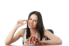 Eating litchi fruits Stock Photos