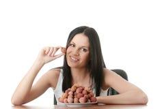 Eating litchi fruits Stock Photos